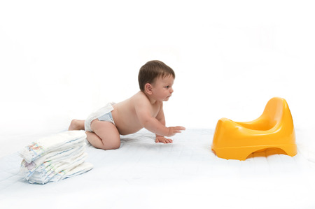 nappies: 8-months baby with nappies and potty Stock Photo