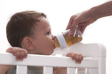Mother feeding her baby with bottle photo