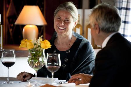 Senior couple having dinner at the restaurant photo