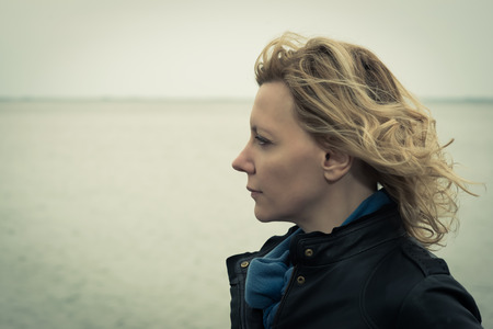 only women: Portrait of a woman on a windy day