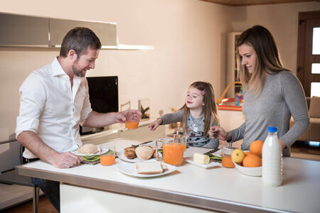 having breakfast: Young family having breakfast together Stock Photo