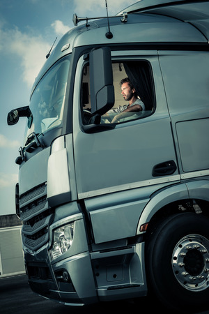 truck driver: Portrait of a truck driver sitting in cab