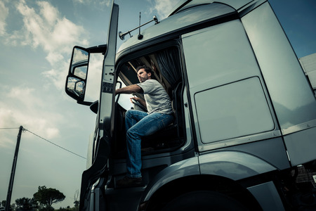 Truck driver coming out of track Stock Photo