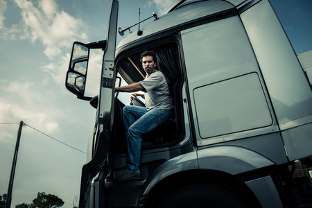 Truck driver coming out of track Stockfoto
