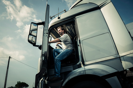 truck driver: Truck driver coming out of track Stock Photo