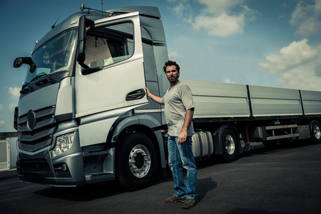 leaning on the truck: Portrait of a truck driver Stock Photo