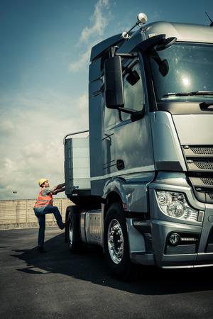 Truck driver preparing his truck