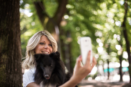 pet photography: Young woman making a selfie with her dog