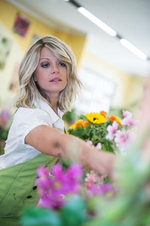 Portrait of a young florist arranging flowers Stock Photo