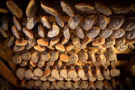 shop interior with hanging hams for seasoning 版權商用圖片