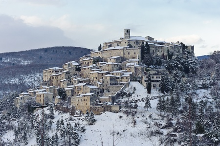 Italian medieval village, called Labro, after a snowfall in February  12