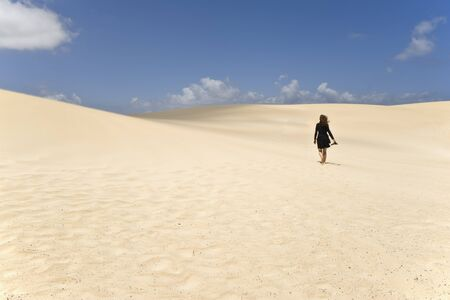 Looking for herself, between the Dunes