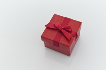 Red Gift Box, with a Red Bow, on a white background photo