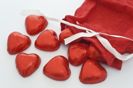 santa s bag: Chocolate Hearts come out of a Christmas stocking