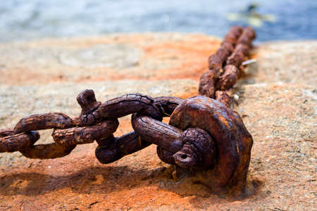 rusty chain: Old Rusty Chain On a Cliff close up