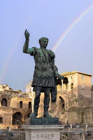 spqr: Julius Caesar Emperor statue in Rome Rainbow Stock Photo
