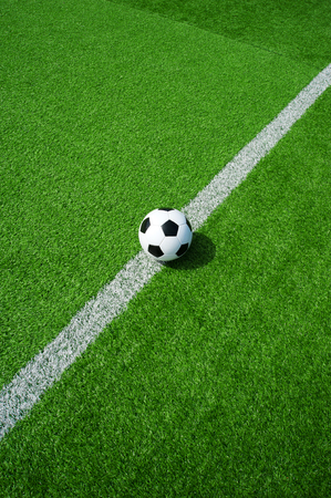 soccer ball on the line of a football field, space for text, good for banner and header
