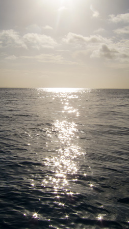 Sea water against the sun with big reflections