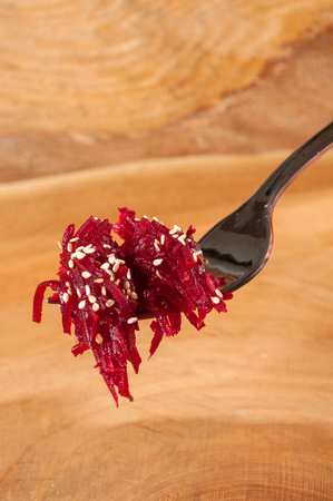 vegan cooking, beetroot on wooden background, on a spoon