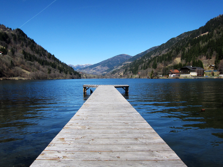 A wooden pier at a lake in Austria