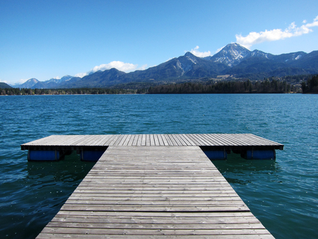 Wooden board walk at a lake in Austria