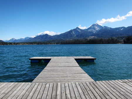 pier at a lake in austria in summer