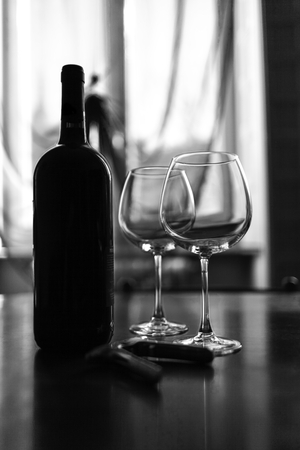 Backlight. Composition of two glasses and wine bottle Stock Photo