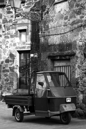 A three-wheeler parked in an old city center, Italy (Tuscany)