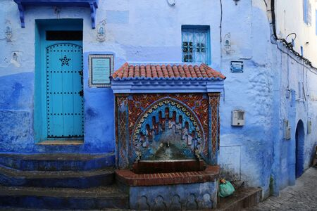 Ancient Andalusian fountain in the town of Chefchaouen Stockfoto - 132090141