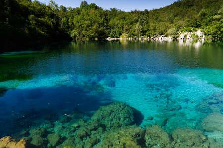 The emerald waters of Lake Cornino in the Cornino regional nature reserve, Italy