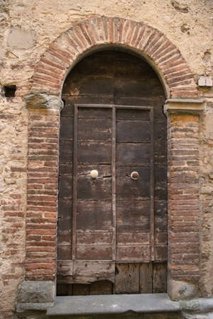 Ancient door in a house of the medieval city of Todi Archivio Fotografico