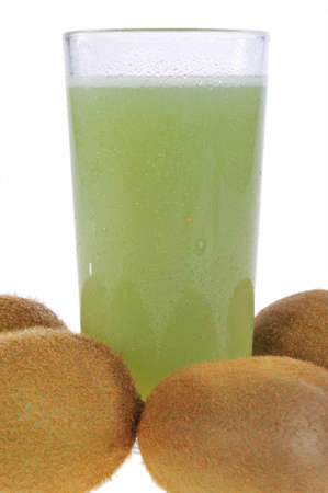 kiwi fruit and a glass of juice on a white background
