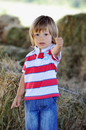 child with his hand raised Stock Photo