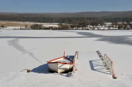 Bridge by boat in winter  photo