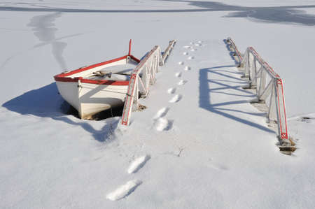 Bridge by boat in winter  photo