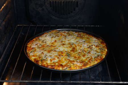 Pizza baked in the oven Stock Photo