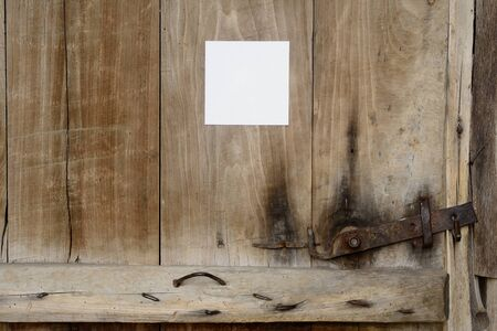 Old door with a note Stock Photo