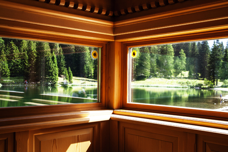 non urban: Wood windows with a lake view inside the Dolomites (Italy)