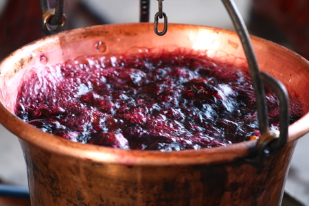lambrusco: huge copper cauldron with the tasty mulled wine cooked over the open fire