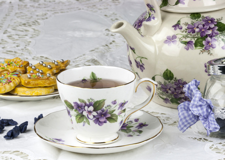 English afternoon tea with cookies and candied violets