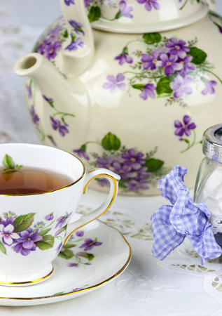party time: English afternoon tea with sweet and candied violets