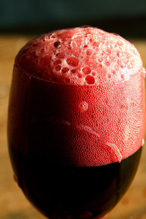 lambrusco: A glass of italian wine (Lambrusco) with a lot of bubbles Stock Photo