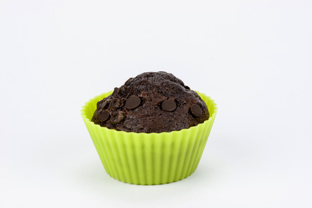 Close up of chocolate muffins on a white background photo