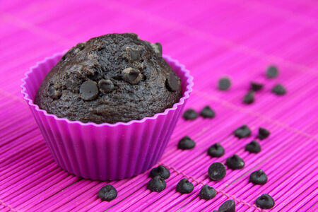 Close up of chocolate muffins on a wooden and pink placemat photo