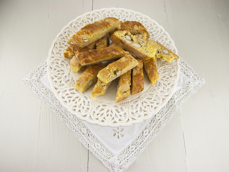 cake stand: Cantucci, a tipical tuscan biscuits on a white cake stand.
