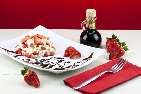 balsamic: Strawberry risotto with traditional italian balsamic vinegar of Modena Stock Photo