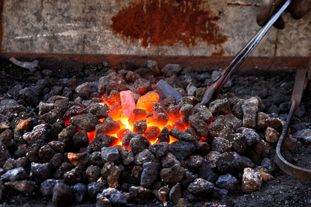 medieval blacksmith: Embers and Flame of a smiths forge
