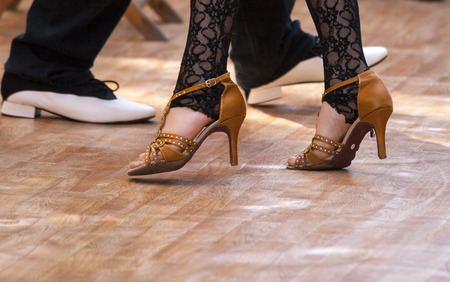 Two tango dancers passion on the floor Stock Photo