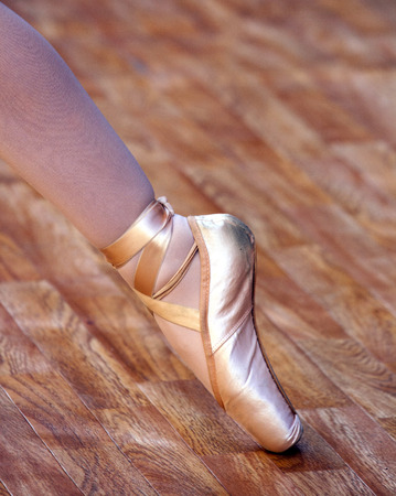 pointes: A ballet fragment with little girls legs on pointes