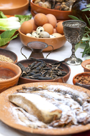 asterix: Preparing ancient Roman food - eggs, fish, beans, etc...